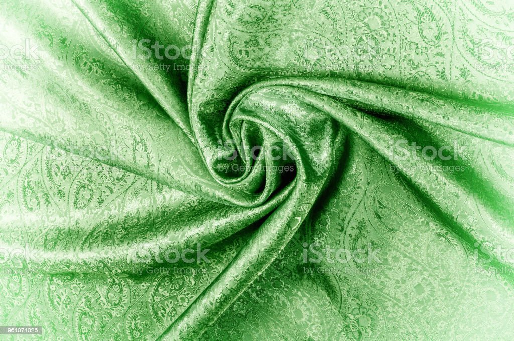 """Background texture, pattern. Paisley Silk green Jacquard is a complex woven glossy fabric with a woven design. Weaving creates the effect of a """"shadow"""" pattern or print. - Royalty-free Beauty Stock Photo"""