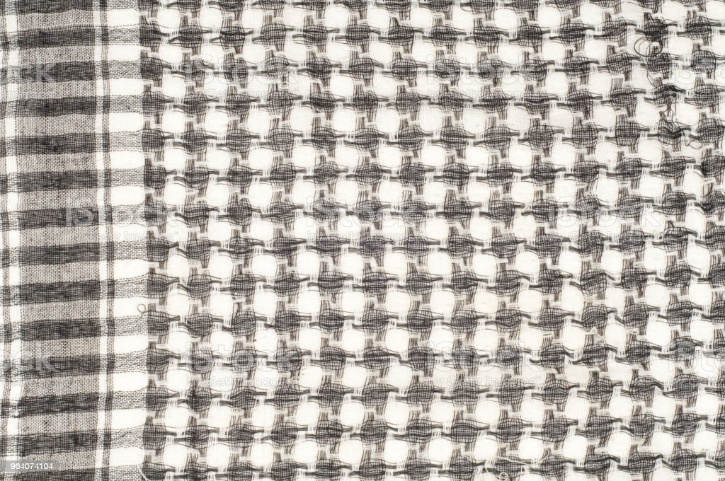 Background texture, pattern. Scarf wool like Yasir Arafat. The Palestinian keffiyeh  is a gender-neutral chequered black and white scarf that is usually worn around the neck or head. - Royalty-free Adult Stock Photo