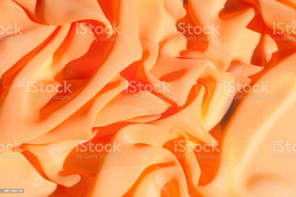 Background texture pattern. Silk crepe of chiffon peach peachpuff Introducing the sultry and stunning  Silk Satin you see here. Duchess satin is a gorgeous high-fiber count medium-bodied low luster stock photo
