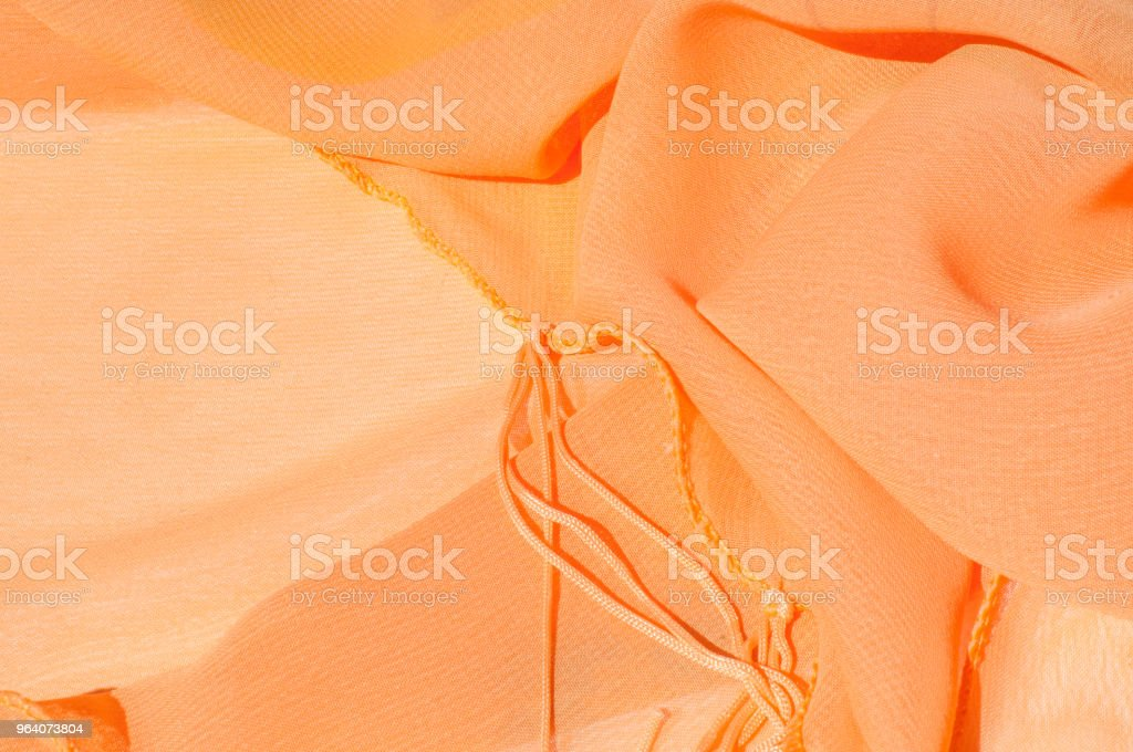 Background texture pattern. Silk crepe of chiffon peach peachpuff Introducing the sultry and stunning  Silk Satin you see here. Duchess satin is a gorgeous high-fiber count medium-bodied low luster - Royalty-free Abstract Stock Photo