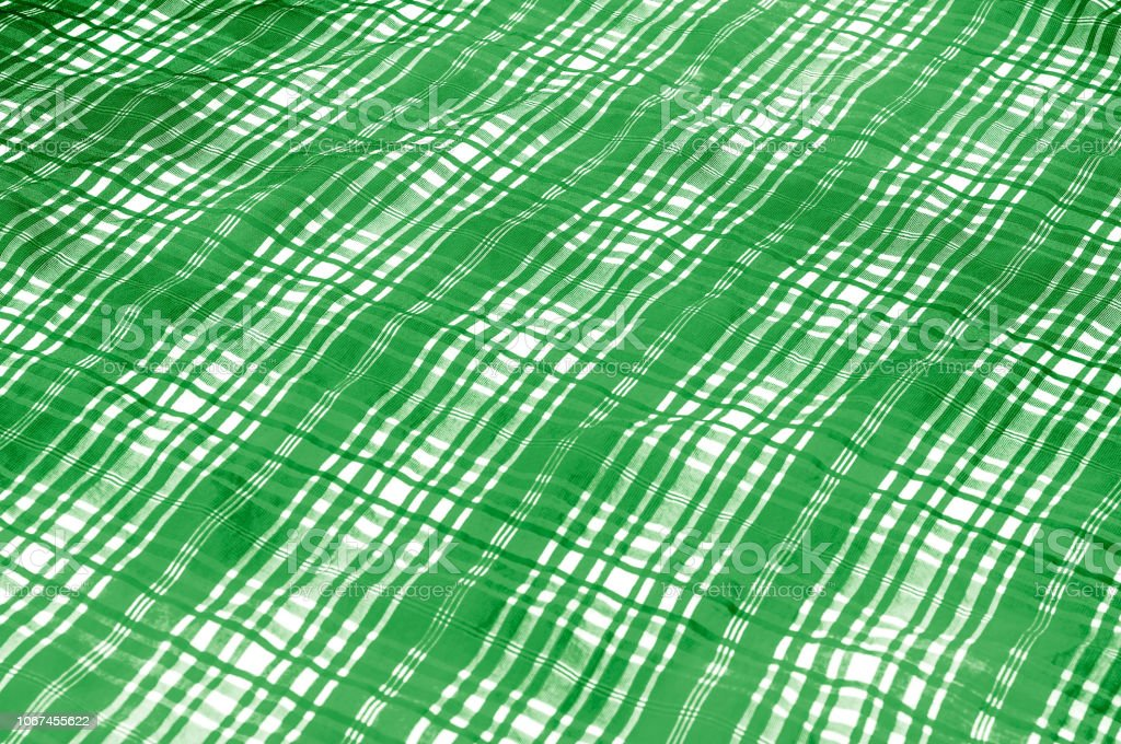 background texture. silk fabric checkered green white. beautiful silk...