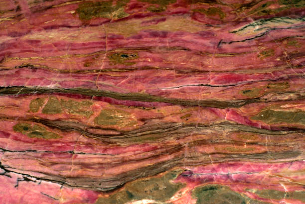background, texture - surface of a rhodonite block stock photo