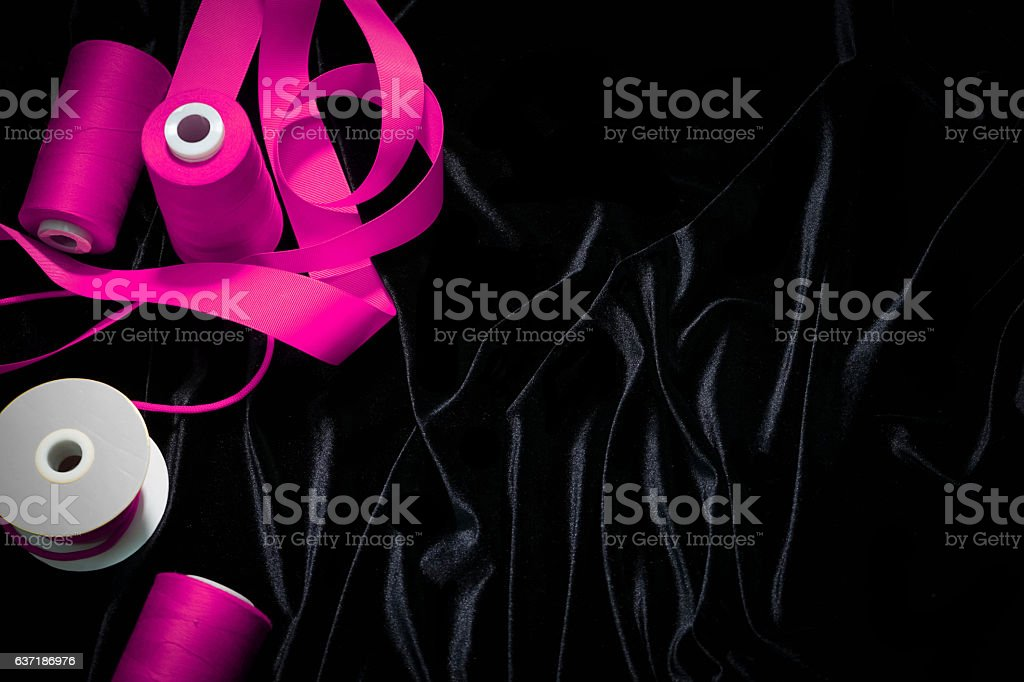 background threads, ribbons on a black , pink, Magenta stock photo
