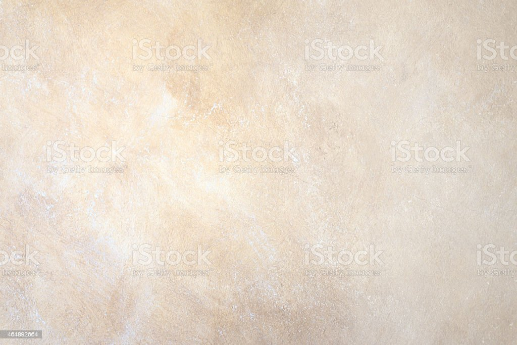 A background wall of abstract rock in beige stock photo