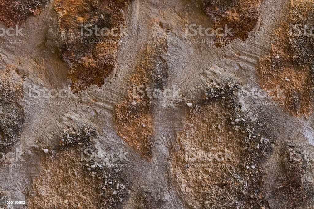 background wall stone brown base urban weathered close-up texture stone rough surface stock photo