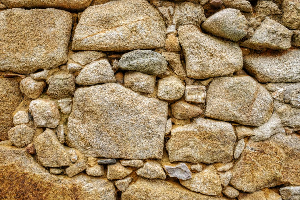 background wall with exposed stone stock photo
