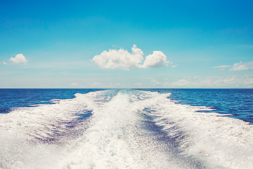Background water surface behind fast moving motor boat vintage retro