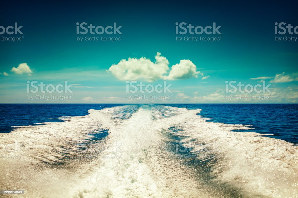 Background water surface behind moving motor boat  vintage retro style stock photo