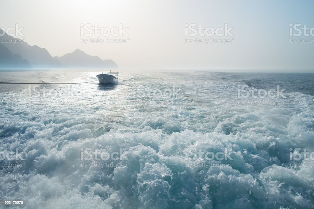 Background water surface behind of fast moving motor boat in vintage retro style stock photo