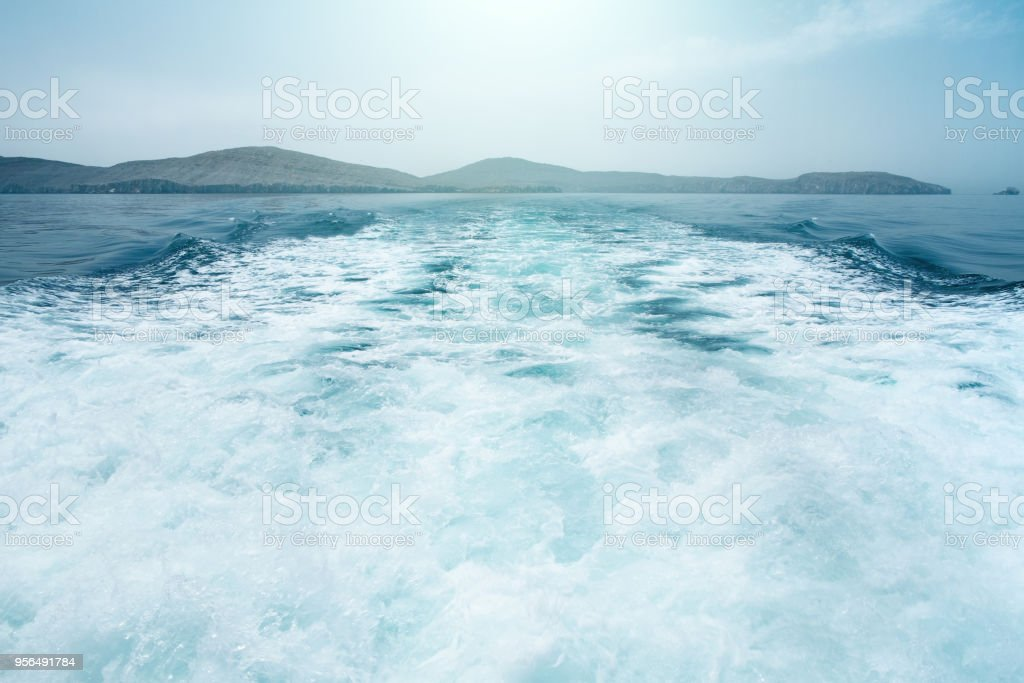 Background water surface behind of fast moving motor boat in vintage tone retro style stock photo