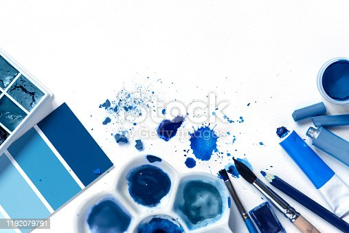 istock Background with art supplies and classic blue colors 1192079791