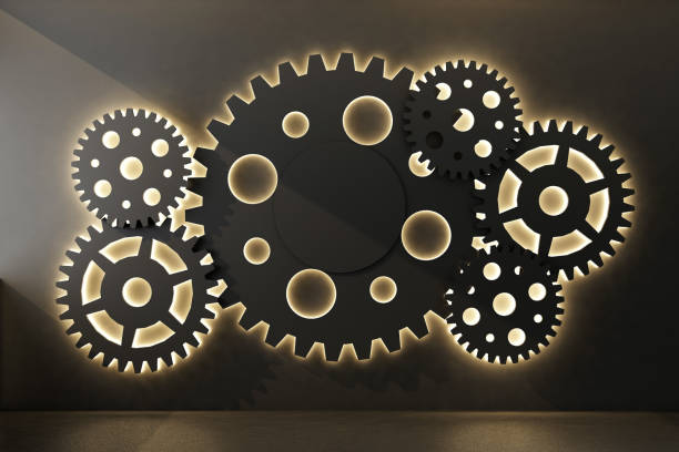background with black gears on wall stock photo