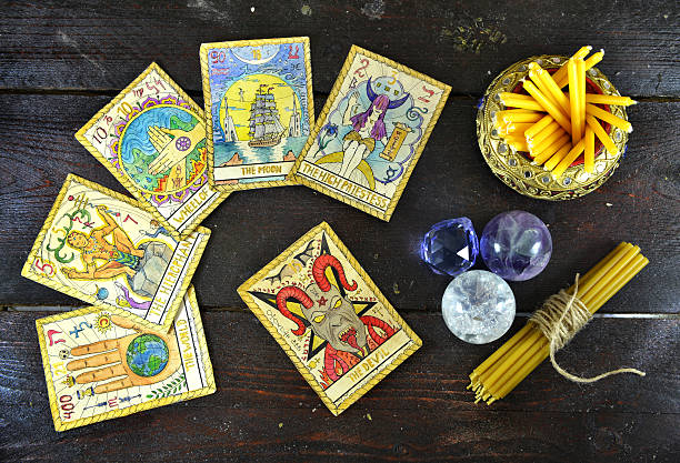 Background with candles, crystal and tarot cards stock photo