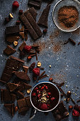 Top view of different chocolate and raspberry. Beautiful background or wallpaper