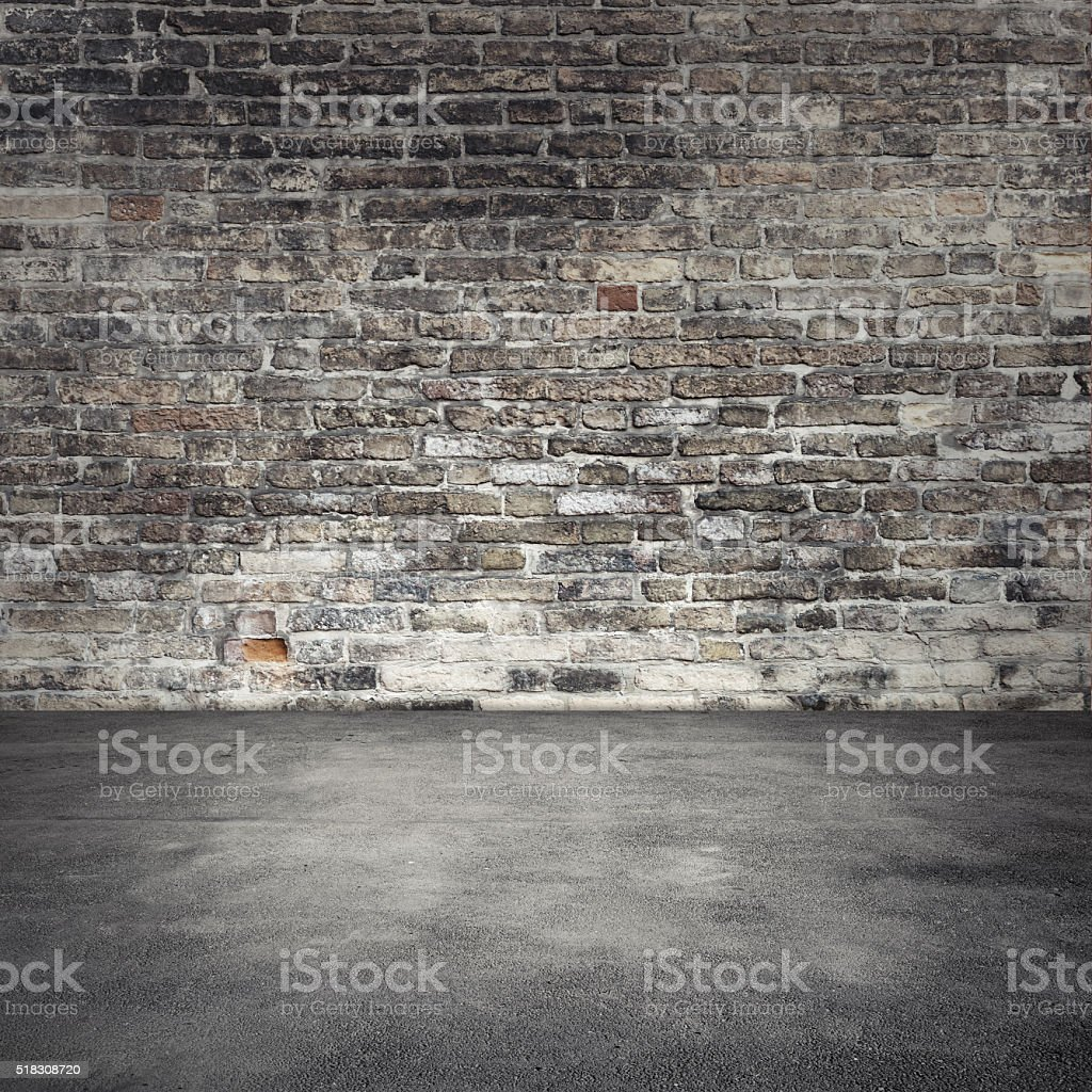 Background With Dark Old Brick Wall And Asphalt Royalty Free Stock Photo