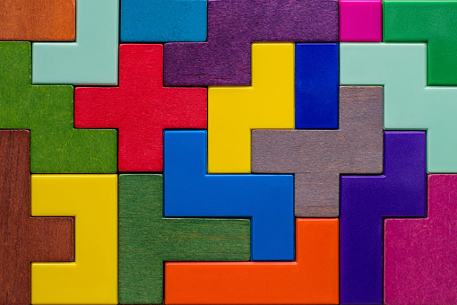 Abstract Background. Background with different colorful shapes wooden blocks. Geometric shapes in different colors. Concept of creative, logical thinking or problem solving.
