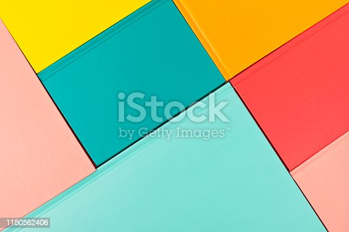 istock Background with empty colored book covers. Mockup, copy space. Study, reading, culture concept 1150562406