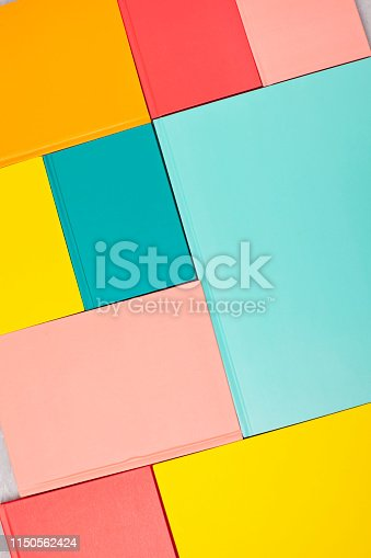 istock Background with empty colored book covers. Mockup, copy space. Study, reading, culture concept 1150562424
