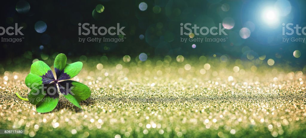 Background with four leaf lucky clover stock photo