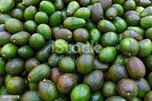 Background with fresh avocado, closeup, selective focus