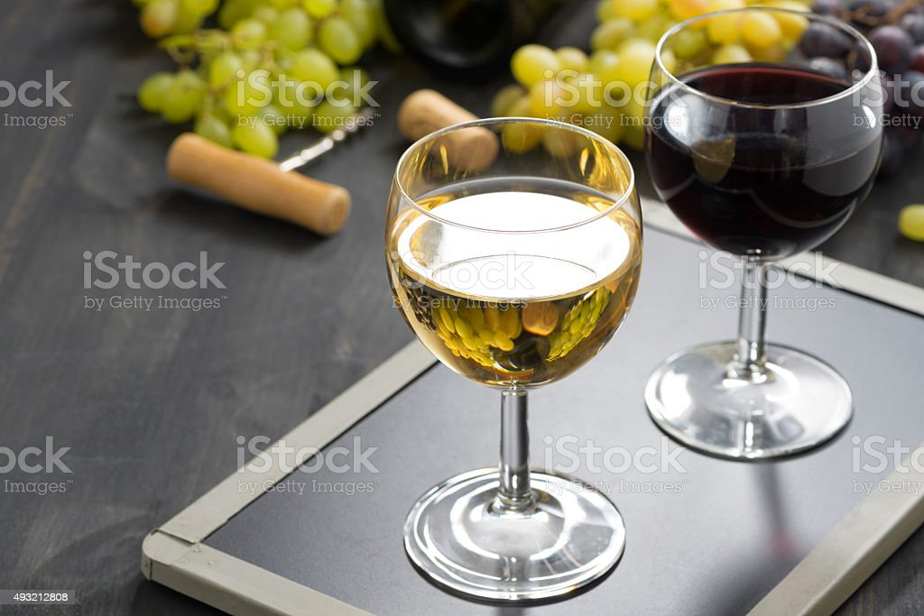 background with glasses of red and white wine stock photo