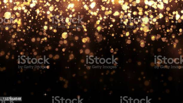 Background with golden glitter falling particles beautiful holiday picture id1127544548?b=1&k=6&m=1127544548&s=612x612&h= elnnl3vn2bos7bsqiuit7qw22en j0ei3gxxddkfls=
