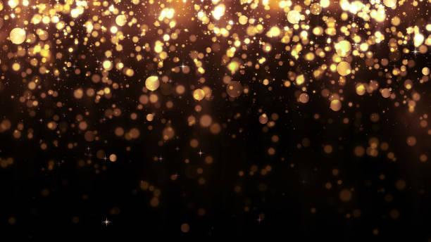 tło ze złotym brokatem spadającymi cząstkami. piękny szablon tła wakacje dla projektu premium. spadająca cząstka złota z magicznym światłem - migoczący zdjęcia i obrazy z banku zdjęć