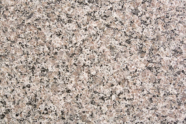A background with granite texture Nice neutral granite background. Many uses! granite rock stock pictures, royalty-free photos & images