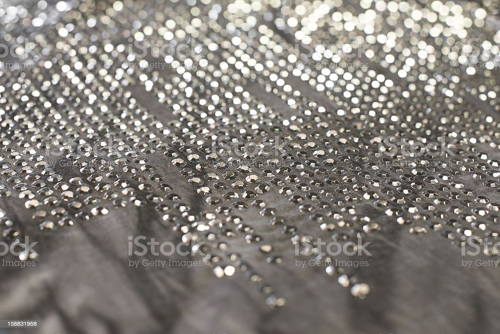 background with gray cloth and metal studs stock photo
