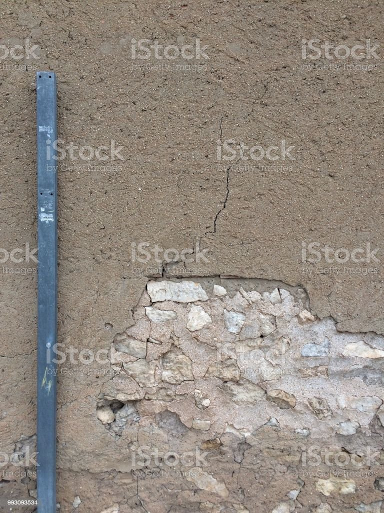 Background With Gray Post And Brown Wall With Crack Concrete