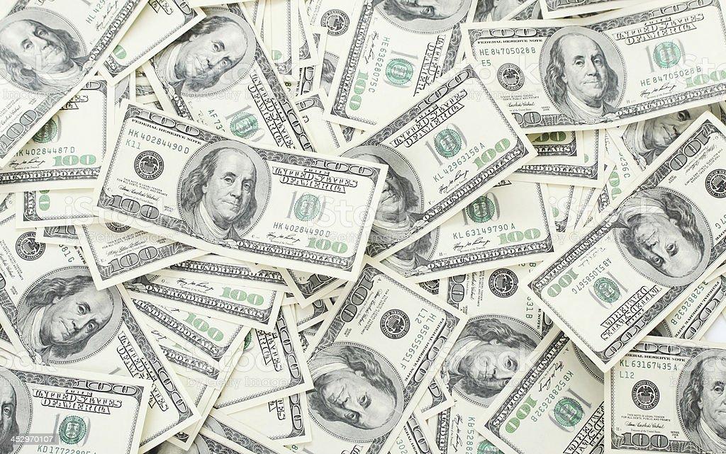 Fundo com notas de 100 dólares americanos de dinheiro - foto de acervo