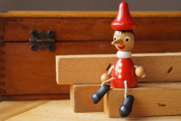 Background with Pinocchio wooden doll Background with Pinocchio wooden doll pinocchio stock pictures, royalty-free photos & images