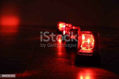 istock Background with red flashing alarm lights. 933292252