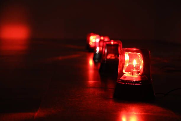 Background with red flashing alarm lights. stock photo
