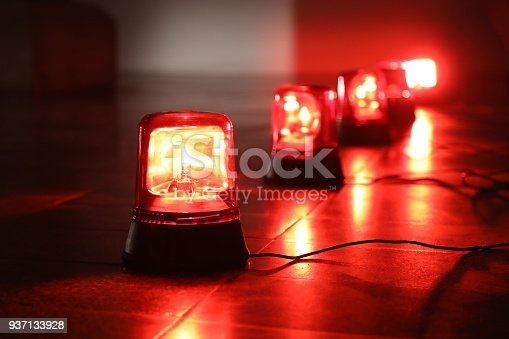 istock Background with red flashing alarm lights. 937133928