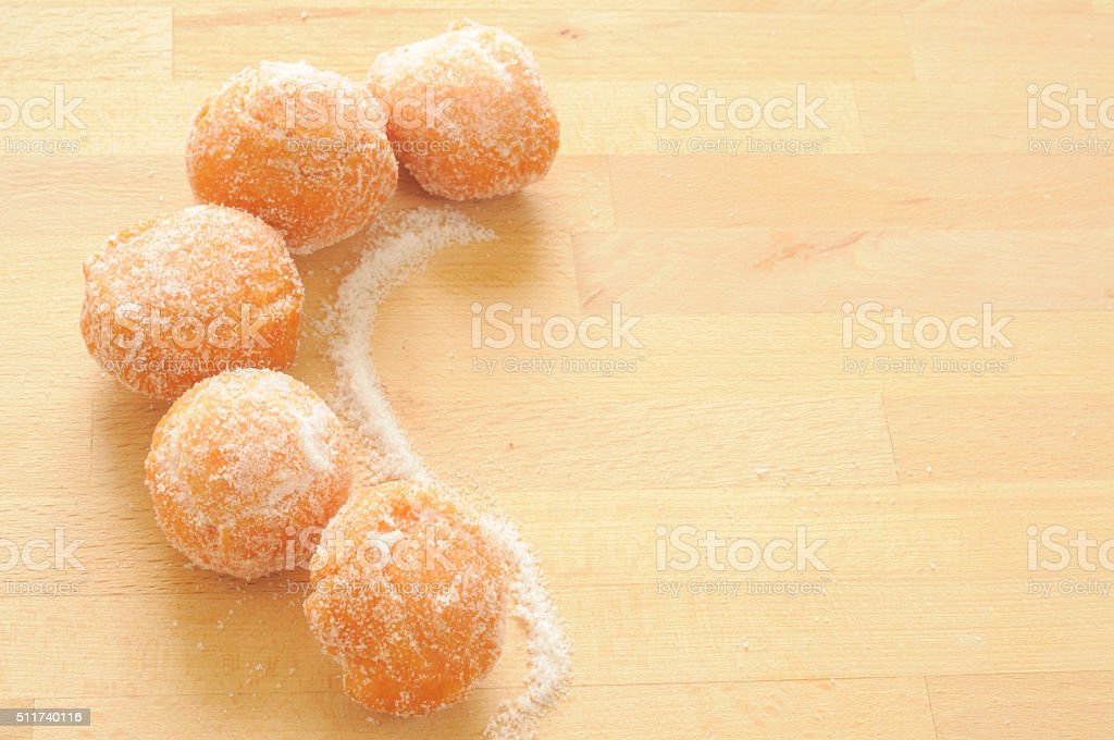 background with sweet fritters and sugar on wood stock photo
