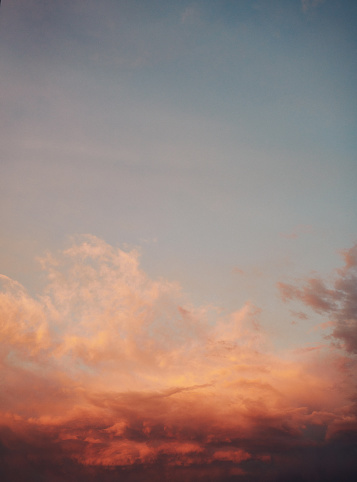 Background with watercolor looking skies with pastel sunset