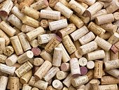background with many French wine bottle oak corks