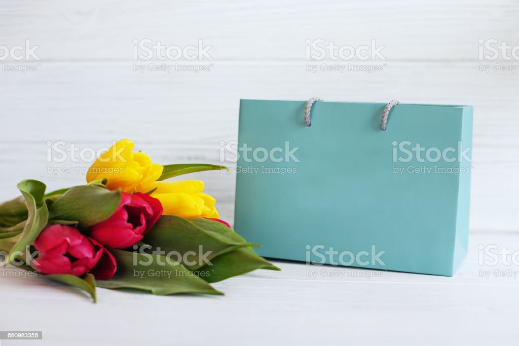 Background with yellow and red tulips and gift. Conception holiday, March 8, birthday, Mother's Day. royalty-free stock photo