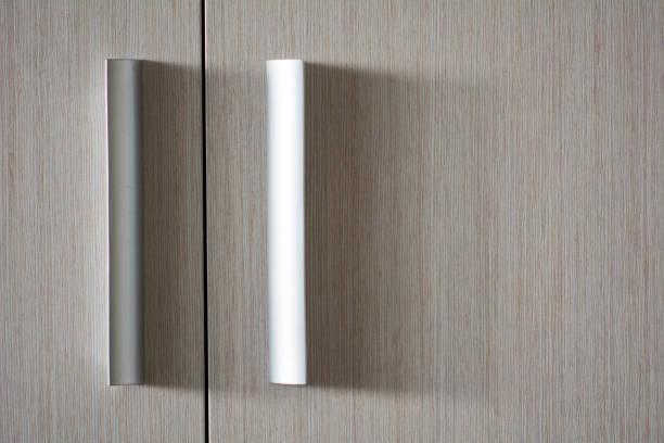 Background wooden texture door with plastic metallic handles stock photo