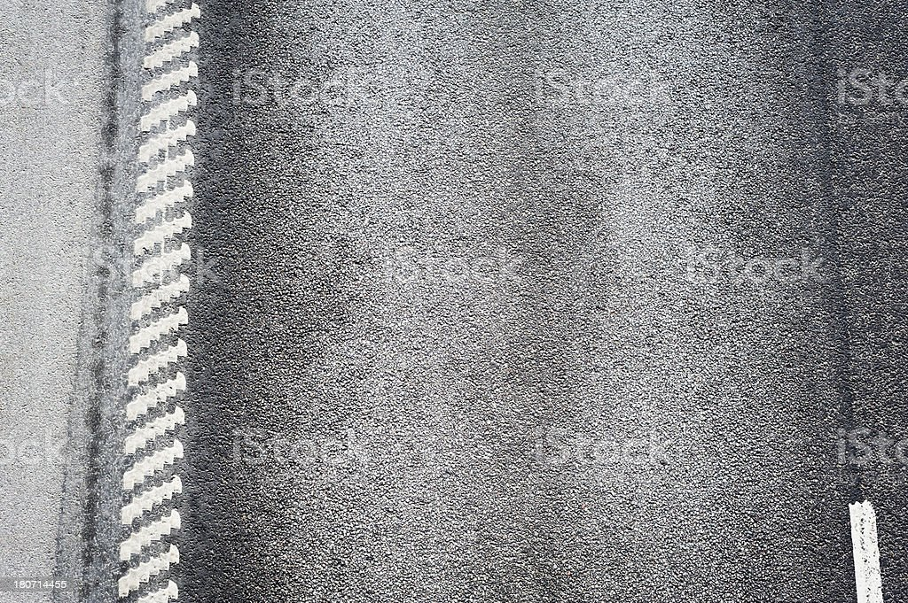 Background: worn road surface with white markings royalty-free stock photo