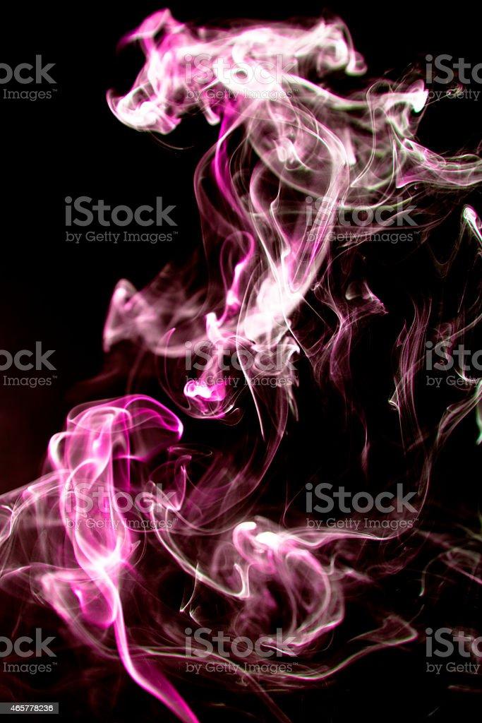 Backgrounds. Hot pink smoke on black background. stock photo