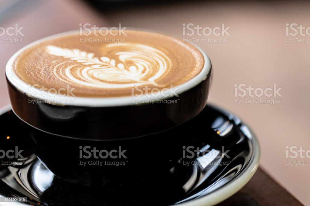 Backgrounds of Latte coffee. coffee cup latte art in shop.