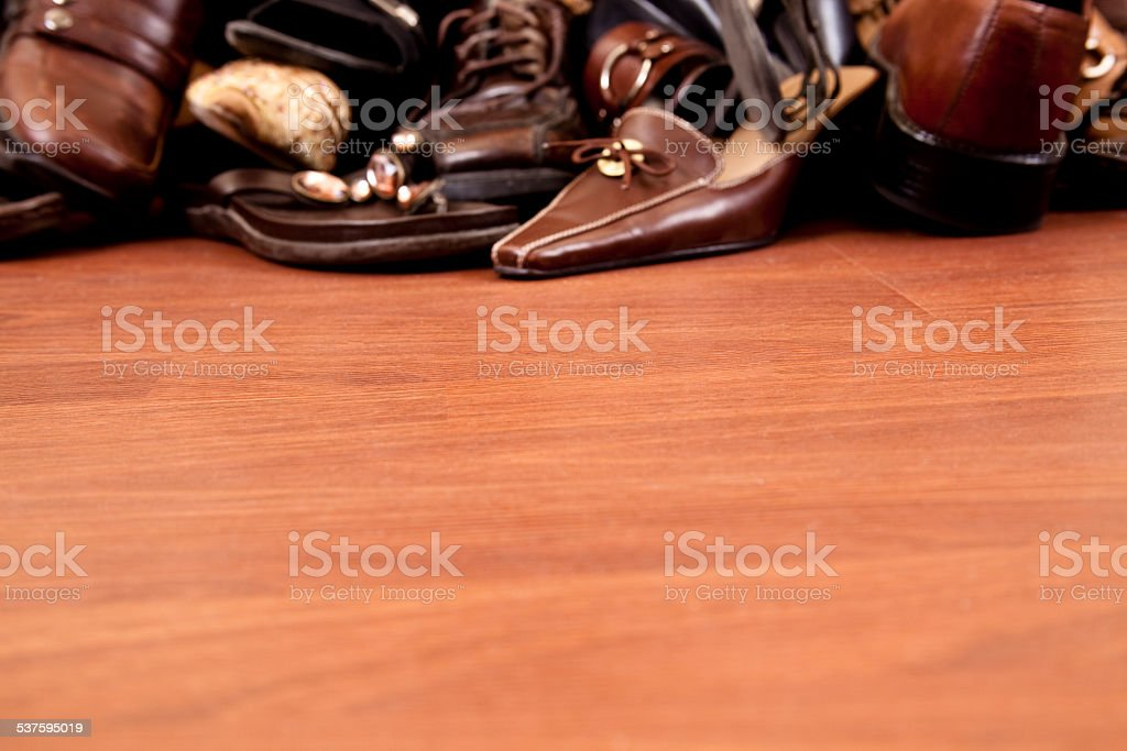 Backgrounds. Pile of many women's shoes. Copyspace foreground. Consumerism. stock photo