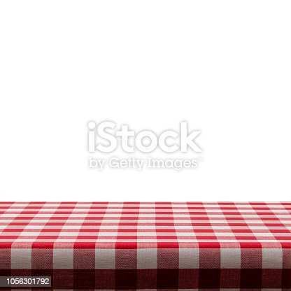 Empty table covered with red and white checkered tablecloth against white background. Ideal for product display on top of the table. Predominant color are white and red. DSRL studio photo taken with Canon EOS 5D Mk II and Canon EF 100mm f/2.8L Macro IS USM.