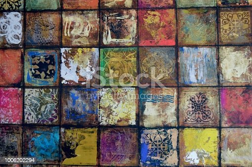 istock A Background/Wall of Rustic, Vintage Colored Squares with Muted Tones 1006202294