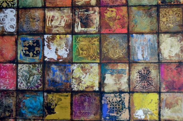 A Background/Wall of Rustic, Vintage Colored Squares with Muted Tones Spanish or southwestern style of vintage colored squares, equally sized, yet all of different designs.  Very colorful, suitable for a background idea. right angle stock pictures, royalty-free photos & images