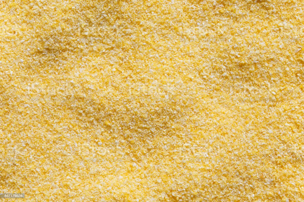 Backgroung of dry cornmeal polenta from above. stock photo