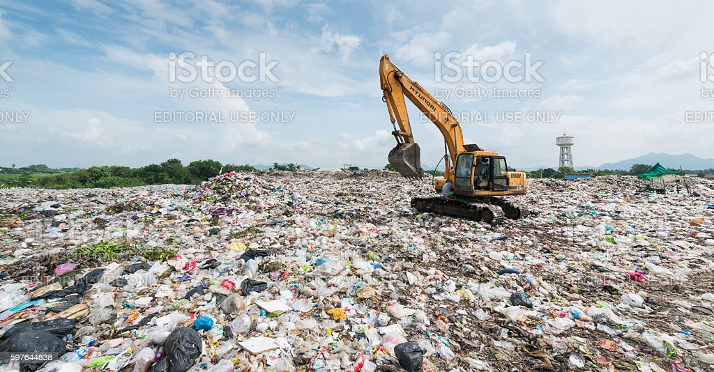 Backhoe car working in the sanitary landfill stock photo