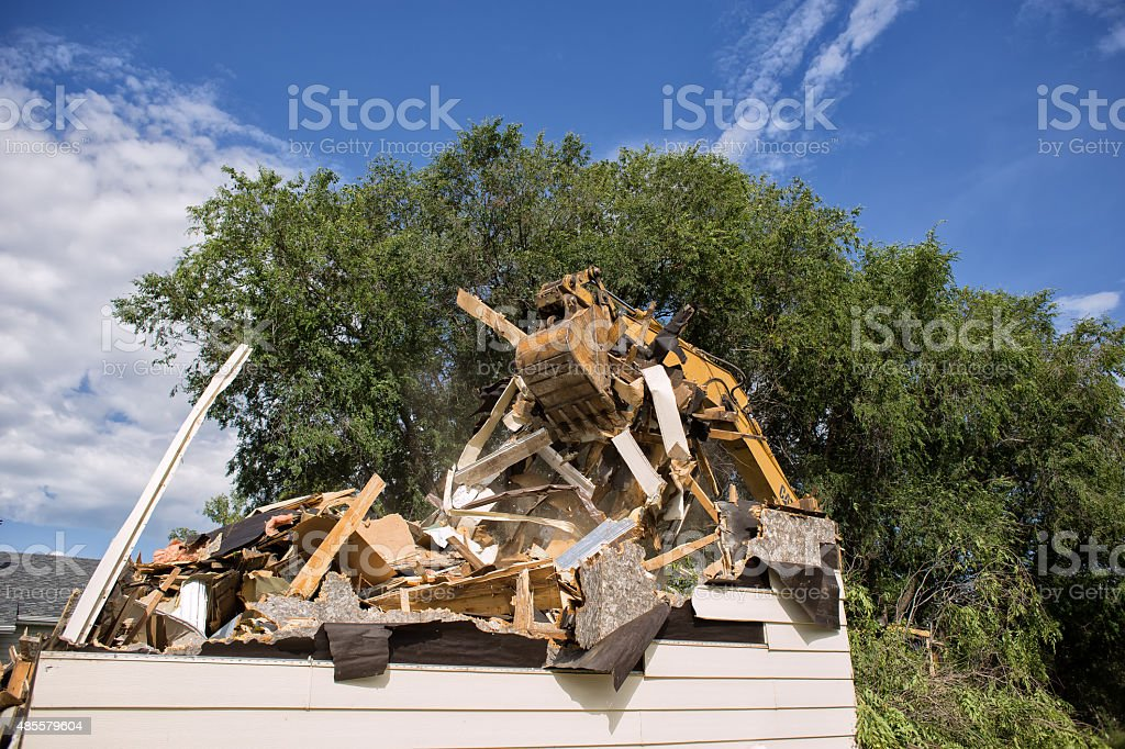 Backhoe claw gripping load of garbage stock photo
